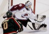 MPX107 - Colorado Avalanche goalie David Aebischer makes a glove-save on a shot by  Minnesota...