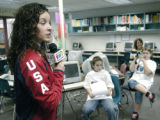 Denver, CO Jan. 26, 2005 US Olympic speed skater Allison Baver is interviewed by fourth and fifth...