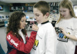 Denver, CO Jan. 26, 2005 US Olympic speed skater Allison Baver autographs the shirt of Hillcrest...