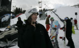 At the base of slopestyle course, Erin Comstock jokes with her friends.  They had decided to end...