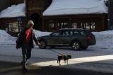 Tim Boulding (cq) walks his dog Swetness down Elk Street Wednesday afternoonJanuary 25, 2006 in...