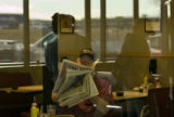 **1/26/06** Rodney Frank of Isabel, S.D. reads the paper during a lunch break at Johnson's Corner...
