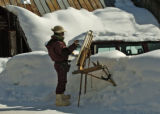 Artist Shaun Horne (cq) works on a painting on Maroon St. Wednesday morning January 25, 2006 in...
