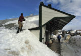 Bryan Turpyn (cq) works on clearing the snow from the roof of the Crested Butte Mountain Heritage...