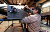 (CANON CITY., Colo., Jan 26, 2006)  Philip DeBuano attaches a belt to a spiral curve section belt...