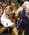 PDA104 - The New Jersey Nets' Jason Kidd (5) forces a jump ball with Portland Trail Blazers'...