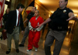 Raul Gomez-Garcia, accused of killing Denver police office Donald Young last year, is escorted out...
