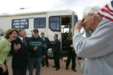 "Local supporter Jim Werstler, of Chandler, Az,  right, takes a photo of Angela ""Bay""..."