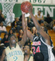 Aurora, CO Jan. 25, 2005 Marcus Johnson (left) of Aurora Central battles with Martell Jackson of...