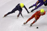 U.S. Short Track skater and former gold medalist Anton Apolo Ohno (#254) tries to stay upright...