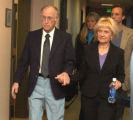 Leland and Judy Boss (cq) , parents of Greg Boss enter court after a break in the preliminary...
