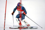 U.S. skiier Bode Miller straddles a gate on his first slalom run, a mistake that most likely cost...