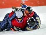 U.S. Ski Team teammates tackle Ted Ligety (on top, pink goggles) in the finish area after it was...