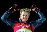 U.S. skiier Ted Ligety raises his arms in celebration after be announced to the crowd as the...