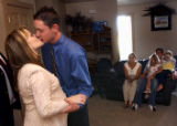 (Vernal, Utah) Amber and Jonathan kiss after being married at their home in Vernal, Utah. They...