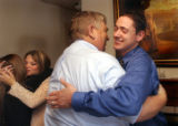 (Vernal, Utah) Jonathan Swain, 21, is congratulated by Amber's father, Kevin Van Tassell, after...