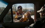 **1/31/06** Efren Hernandez, 22, sells oranges to a passenger buy the bag full from his truck at...