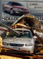 (STERLING, CO., JUNE 10, 2004) A used Chevy car sits covered in debris at Halloway auto dealership...
