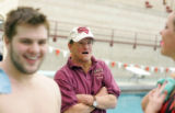 DU diver Aaron Feight, left, an Arapahoe High School graduate, talks with coach Jeff Carter,...