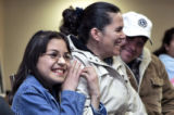 Karina Huerta (cq) 10 and her mother Rosalina Huerta (cq) and father Alfredo Huerta (cq)  react as...