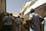 (NYT68) KHARTOUM, Sudan -- Feb. 1, 2006 -- SUDAN-YACHT-2 -- Workers dismantling part of a building...