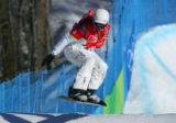 Seth Wescott goes over a jump in the men's snowboard cross final in Bardonecchia, Italy on...