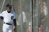 Detroit Tigers' new manager Jim Leyland (10) talks to fans behind the fence during the first day...