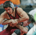 Casey Cruz, left, a junior at Wasson High School tries to break out of a hold put on by Justin...