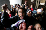 Manual High School student Markus Dandridge, cq, center, yells with other students after they...