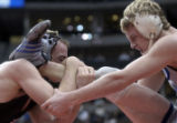 Alamosa's Cody Yohn (left) has Broomfield opponent Shane Mortensen by the ankle in the 4A 152...