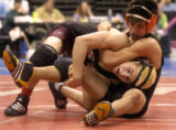 Alamosa's Tommy Valdez, foreground, and Greenley Central's Michael Rangel wrestle in the 4A 125...