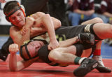 Cody Clark, top, of Meeker High School, hold down Andrew Pauley of Sargent High School, bottom,...