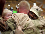 Sergeant Leroy Scott, cq, right, a member of 2/3 Armored Cavalry Regiment, hugs fellow trooper...