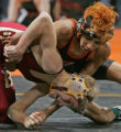 Justin Rangel, top, of Lamar High School, holds Cole Kemblel of Brush High School in 103 lb 3A...