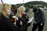 Mary Leigh Seaton(cq), left, along with Kathy Kinnard(cq), middle, check off names and hand out...