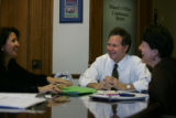 Cole Finegan (Cq), center, Denver's city attorney and the mayor's chief of staff meets with Deputy...