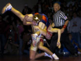 **Requested for file** Chaparral High School's Roman Padilla (cq) gets flipped by Ponderosa High...