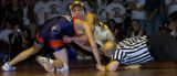 **Requested for file** Ponderosa High School's Jesse Snider (cq) (center) gains an advantage over...