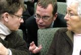 Carol Kobel (cq), of Boulder County, left, and Sue Wise (cq),(r) of Lyons, listen to Michael...