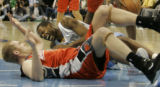 Marcus Camby goes down hard in the 4th period as he tangles with Jake Voskuhl as the Denver...