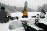 Andy Lynn (cq) speaks about terrain park etiquette during a class he is teaching to snow boarders...