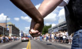 (DENVER, CO., June 27, 2004) Good friends Arthur Richardson and Howard Maki hols hands as they ...