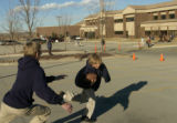 Seventh-graders Travis Eckert (cq), 13, chases Christian Klevdal (cq), 12, (with football) in the...