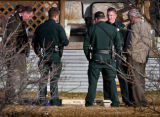 Photo by Dean Humphrey/Grand Junction Daily Sentinel  -- Mesa County sheriff's officials stand...