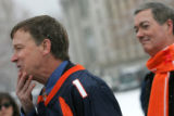 Denver Mayor John Hickenlooper, left, feels the whiskers on his chin as he tries to emulate Jake...
