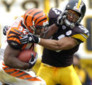 12/4/2005   PITTSBURGH :  Bengals Rudi Johnson stiff arms Steelers Clark Haggans in the 3rd...