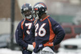 (L-R) Mike Anderson and Tatum Bell  talk  during practice at the Denver Broncos Dove Valley...