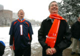 Denver Mayor John Hickenlooper, left, and Colorado Governor Bill Owens laugh after a press...
