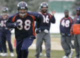 #88 Jeb Putzier runs for a pass from Bronco QB Jake Plummer  during practice   at the Denver...