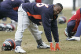 Tatum Bell stretches out during practice at the Denver Broncos Dove Valley Headquarters  in...